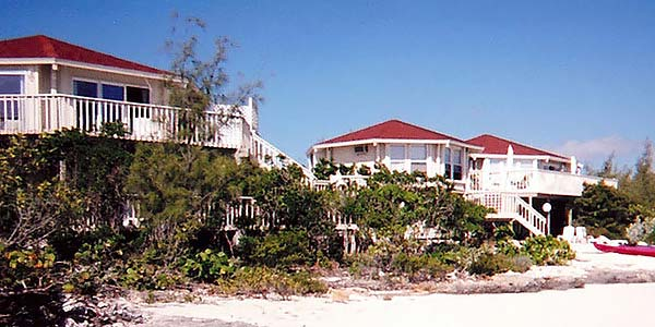 This private family estate features three elevated ocean front houses built on Great Exuma, Bahamas