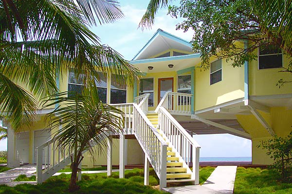This beach front Topsider home is a combination of a two-story house and pedestal home design built on Cat Cay, Bahamas