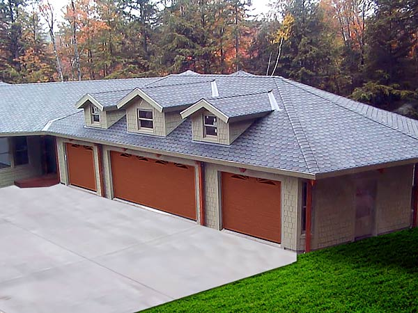 This Topsider four-car prefab garage kit was designed to blend perfectly with the existing home structure