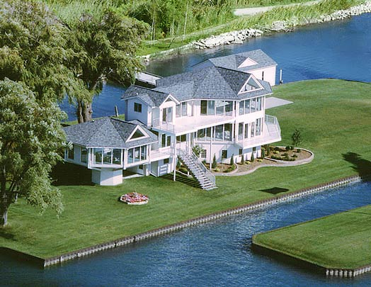 Building elevated homes raised house plan designs by for Luxury lake house plans