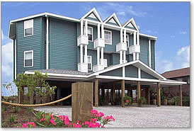 Hurricane proof elevated piling (stilt) houses like this two-story multi-family design are ideal for beachfront settings from the New Jersey Shore to Florida