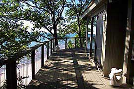 Stainless steel cable railing and composite deck, overlooking the beach. Coastal Oregon