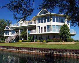 Building tropical climate coastal homes low maintenance for Custom beach house plans
