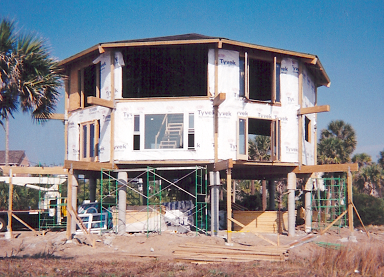 panels attach to laminated timber components built in erector set style and held in - Hurricane Proof Homes Design